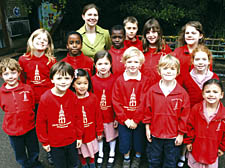 Christ Church Primary School headteacher Katy Forsdyke with some of her pupils who have earned praise