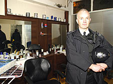 Sgt Chris Walsh with bags of drugs found inside the Firm Cut shop